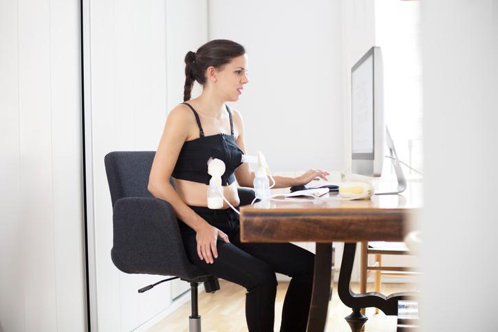 Woman pumping breast milk at work